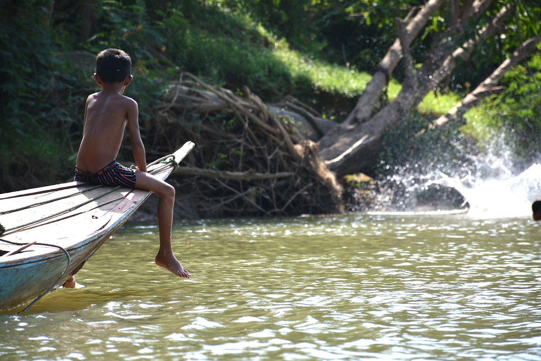 Boating across Sesan River in Cambodia