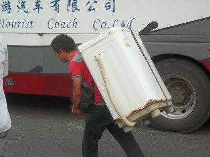chongqing man carrying refridgerator