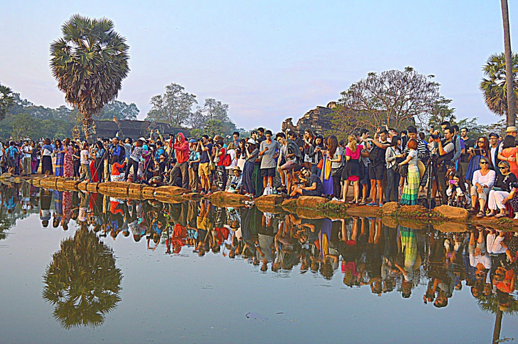 Tourists outside the Angkor Wat temple at 7 am in morning. The crowds continue to increase as the day progresses.